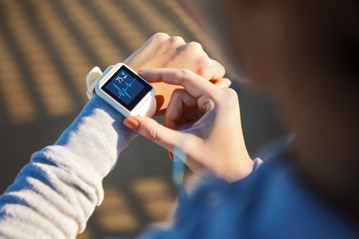 woman checking her heart rate on smartwatch