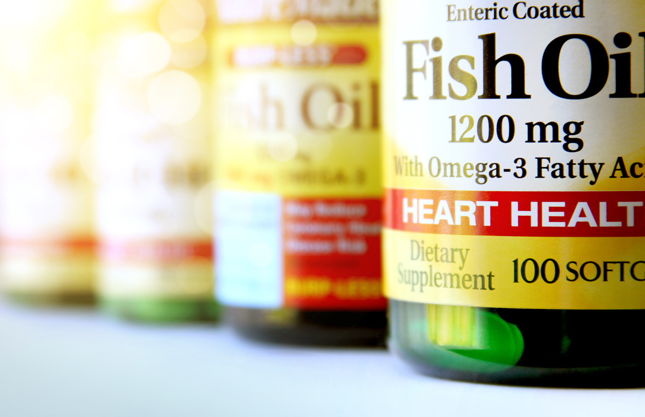 close up of four bottles of fish oil supplements